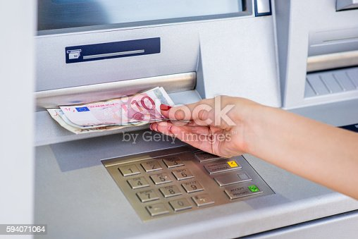 istock money from ATM automatic cash machines 594071064