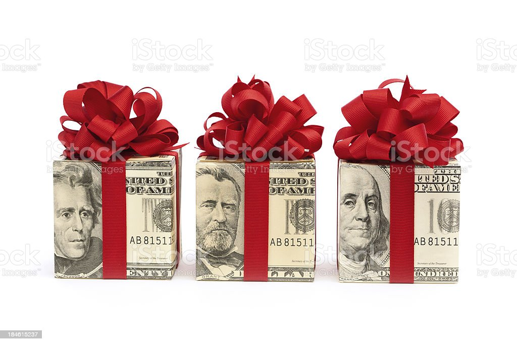 Money Gift—Bills Wrapped in Red Bow, Ribbon on White stock photo