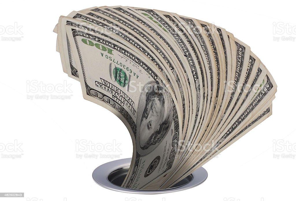 Money going down the drain. stock photo