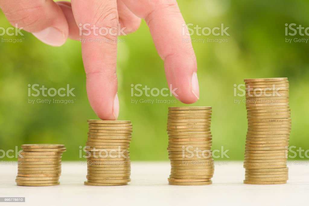 Money Gold coin Steps with green bokeh background ,Business Finance...