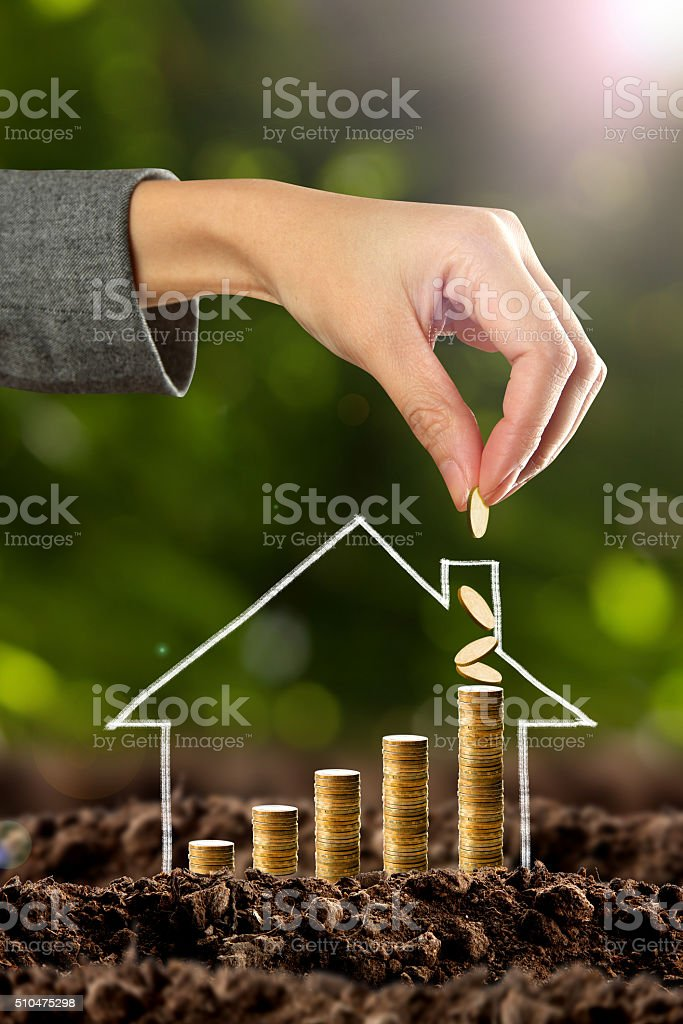 Money growing with house symbol stock photo
