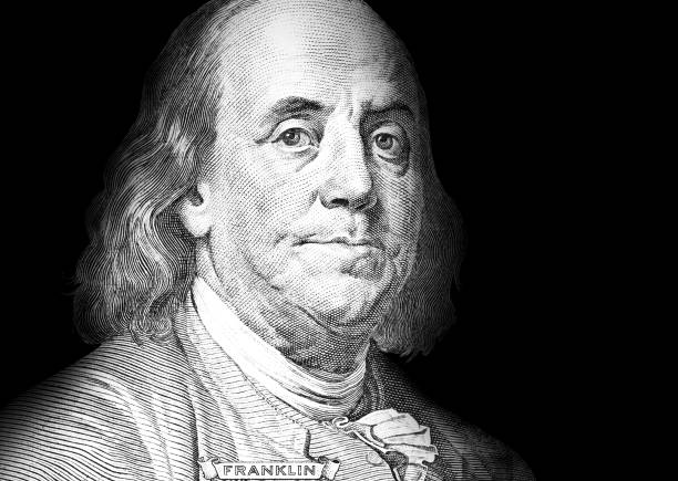 Money Growth Graph A piece of a money bill showing an important person benjamin franklin stock pictures, royalty-free photos & images