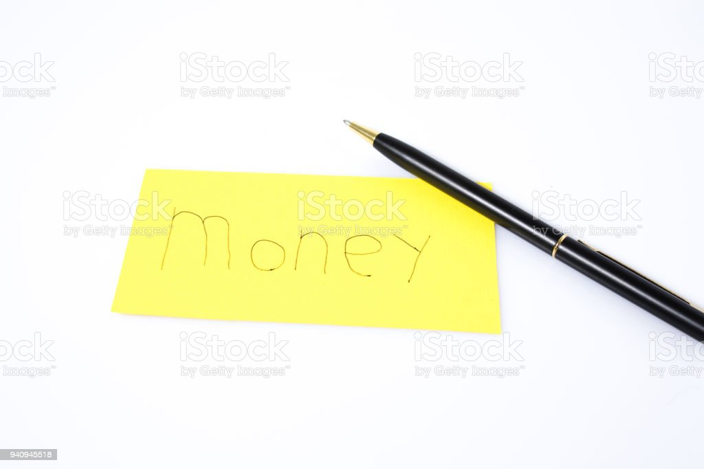 Money handwrite with a pen on a yellow paper composition stock photo
