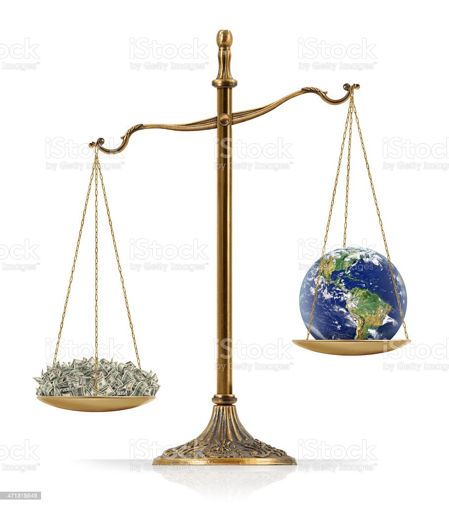 """Money Heavier Than Earth There is money at the one side of """"Scales of Justice"""" while there is world globe on the other side. In this version, money seems heavier than world globe. Isolated on white background. American One Hundred Dollar Bill Stock Photo"""