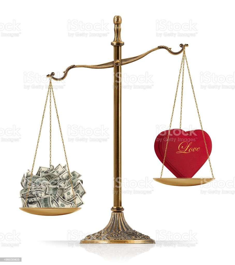 """Money Heavier Than Love There is heart shaped red box at the one side of """"Scales of Justice"""" while there is money on the other side.  In this version, money seems heavier than love. Clean image and isolated on white background. American One Hundred Dollar Bill Stock Photo"""