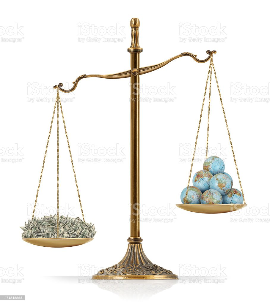 """Money Heavier Than World Globes There is money at the one side of """"Scales of Justice"""" while there are world globes on the other side. In this version, money seems heavier than world globes. Isolated on white background. American One Hundred Dollar Bill Stock Photo"""