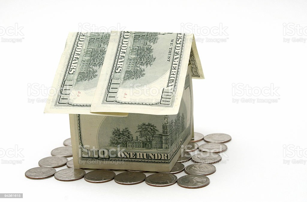 Money house on quarters stock photo