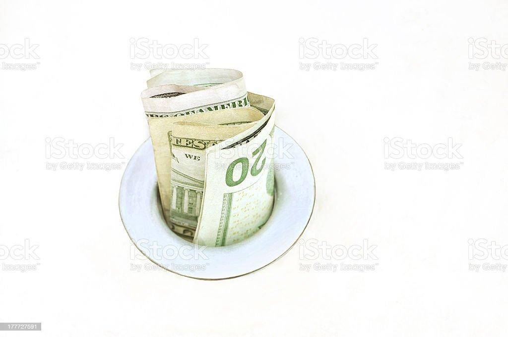 Money in a Drain stock photo