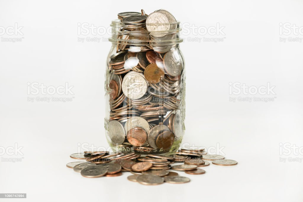 Money in a glass jar foto stock royalty-free