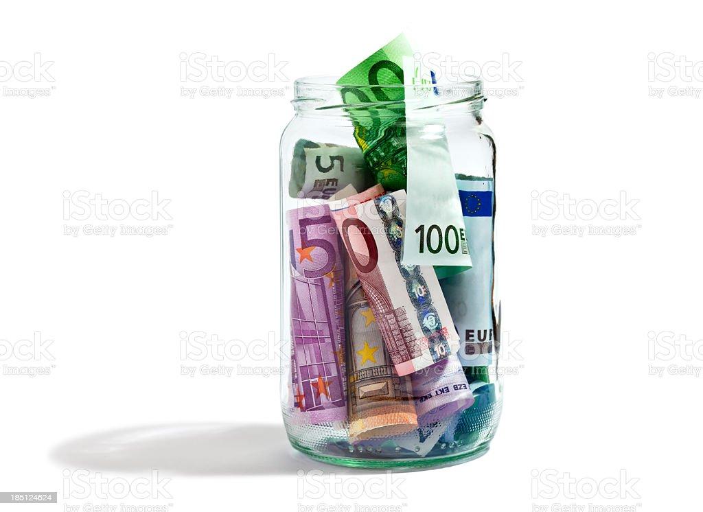 Geld in ein Gefäß geben. – Foto