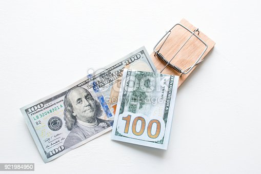 848170878istockphoto money in a mousetrap on a white background concept corruption 921984950