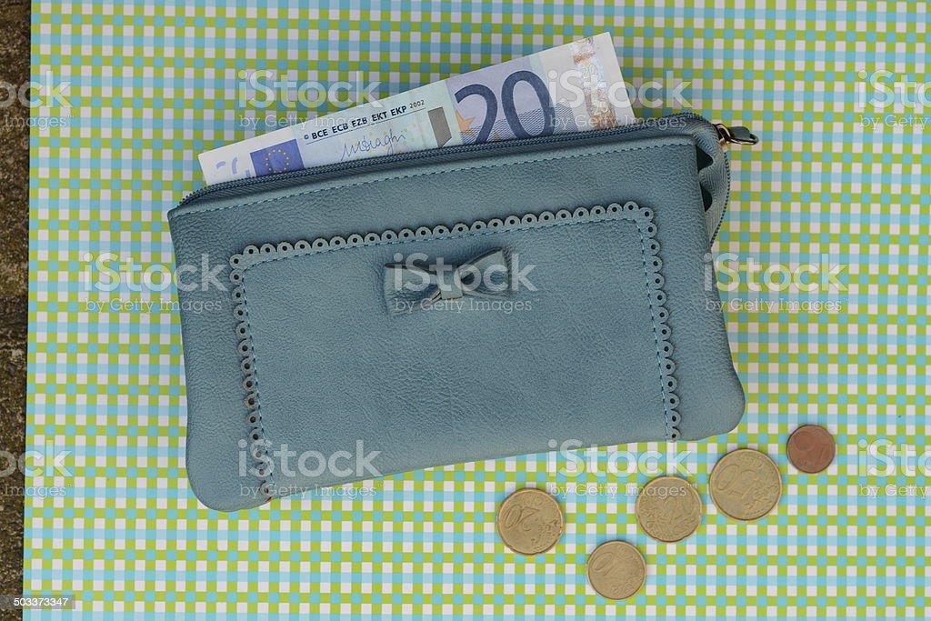money in a blue wallet