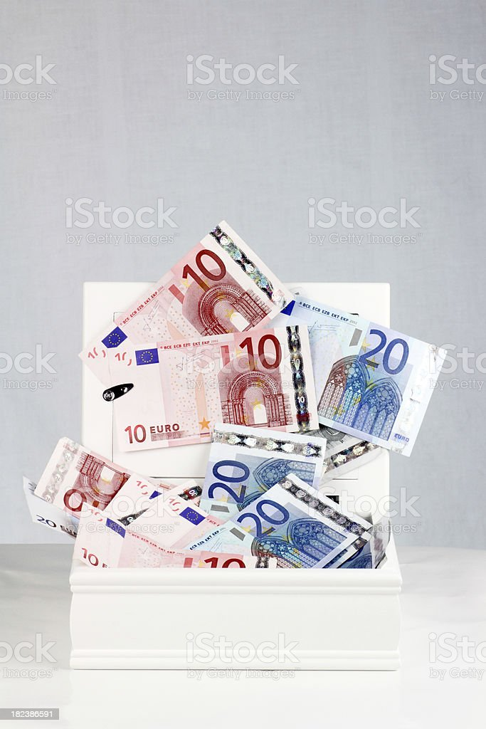 Money in a white box royalty-free stock photo