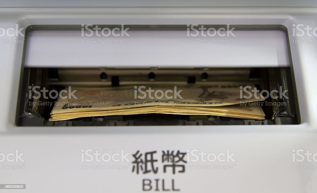 Money in ATM stock photo