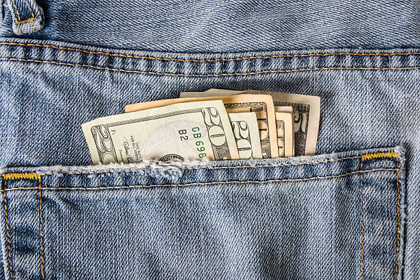 money in back pocket - pocket stock photos and pictures