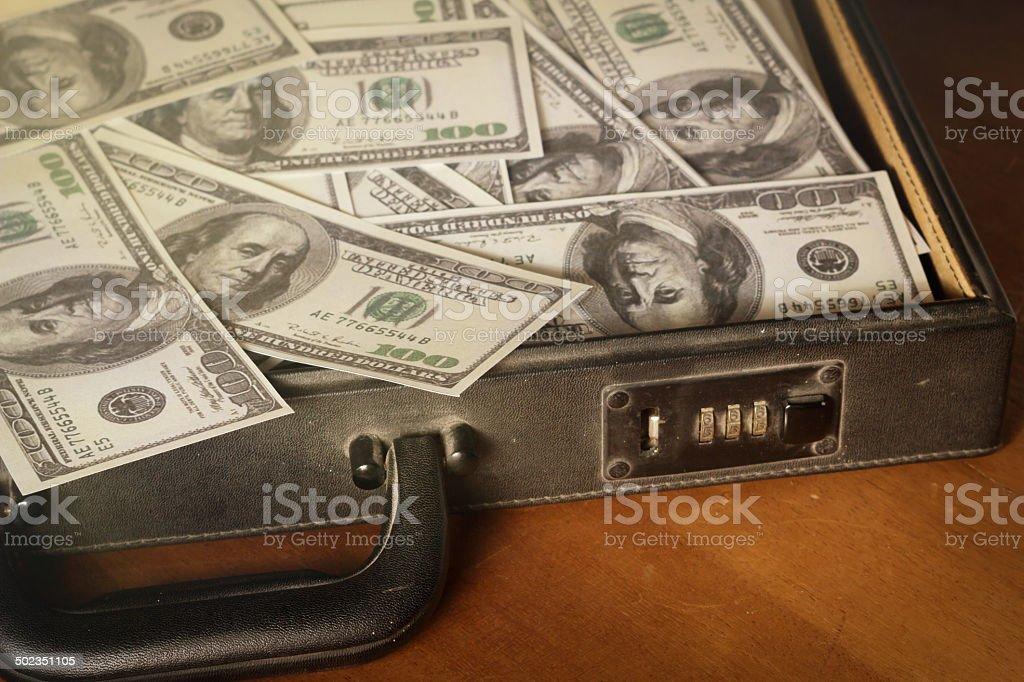 Money in briefcase,vintage style color. Dollars bill in briefcase,vintage style color. Bag Stock Photo