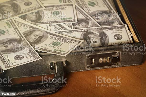 Money In Briefcasevintage Style Color Stock Photo - Download Image Now