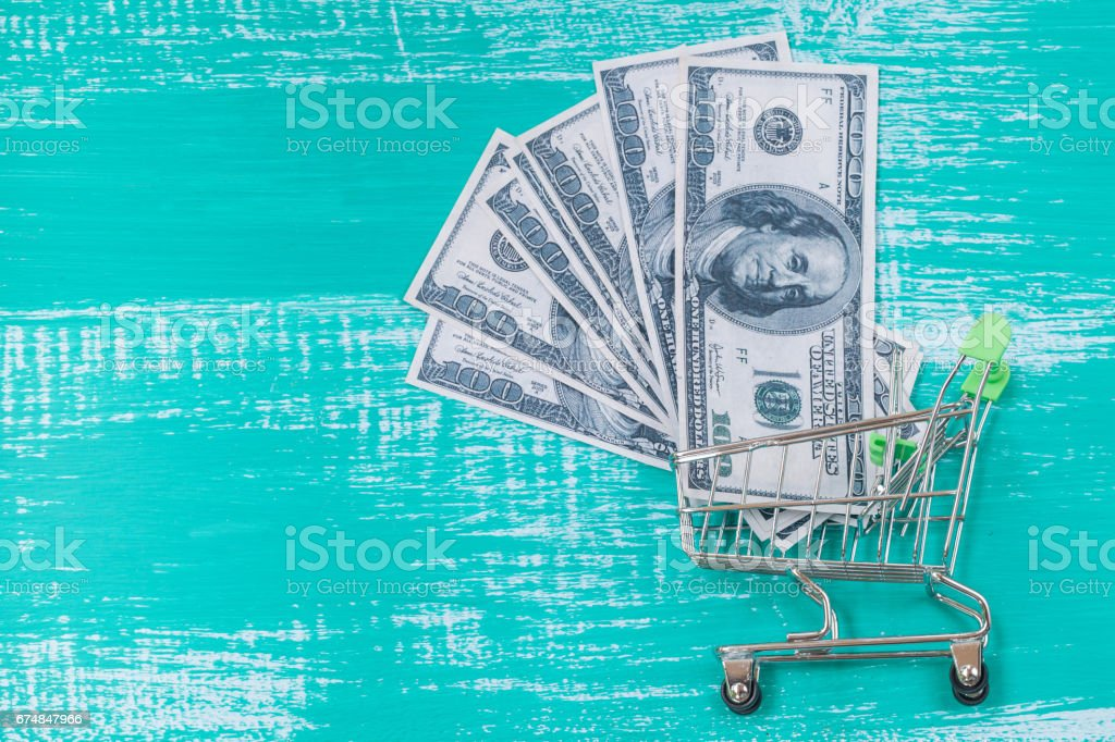 money in cart or trolley ,concept business on line stock photo