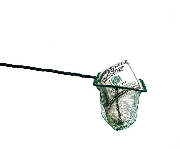 money in fishing net stock photo