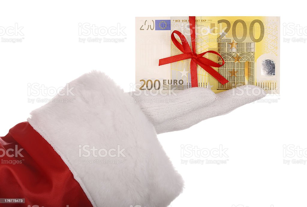 Money in hand of santa claus. royalty-free stock photo
