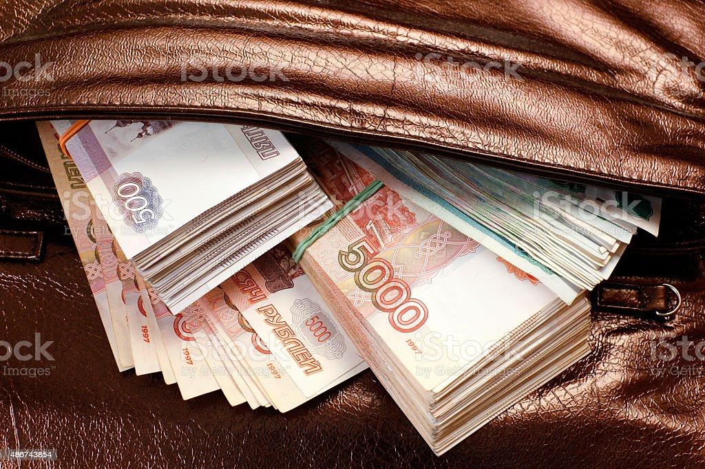 Dinero en handbag - foto de stock