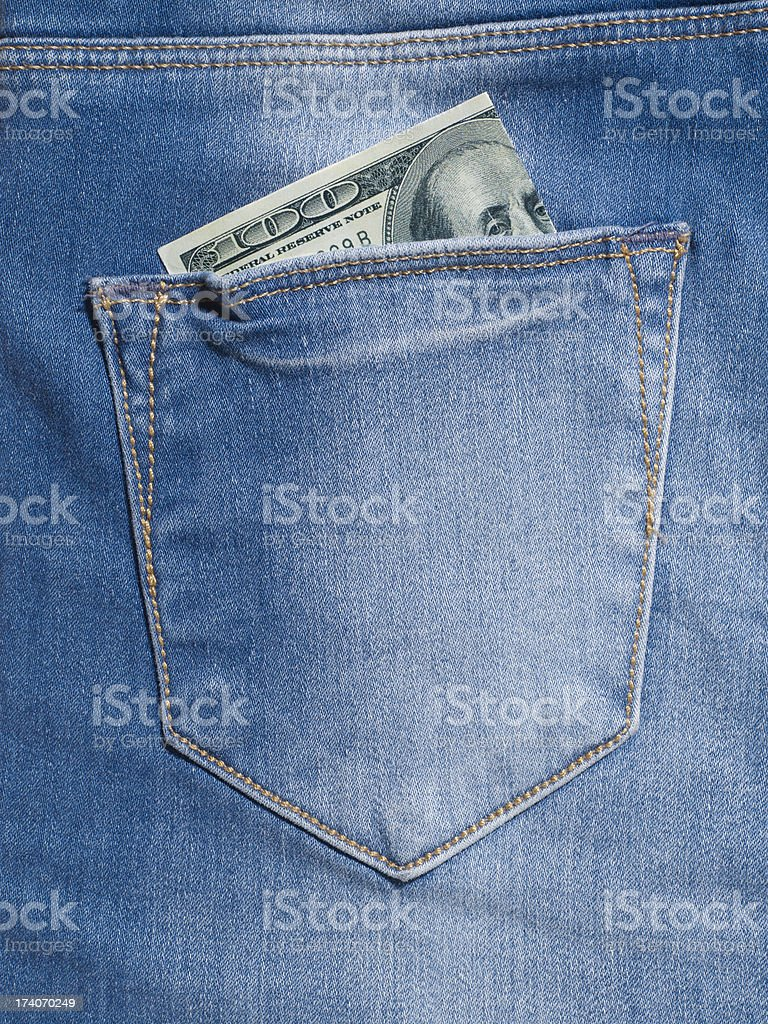Money in jeans pocket royalty-free stock photo