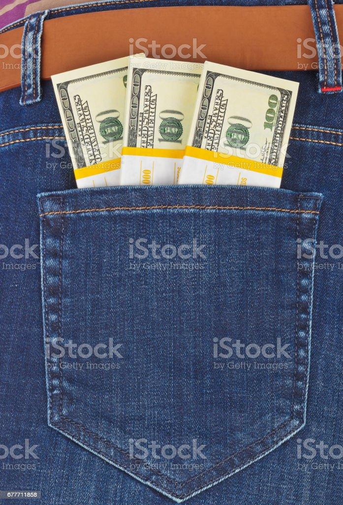 Money in jeans pocket stock photo