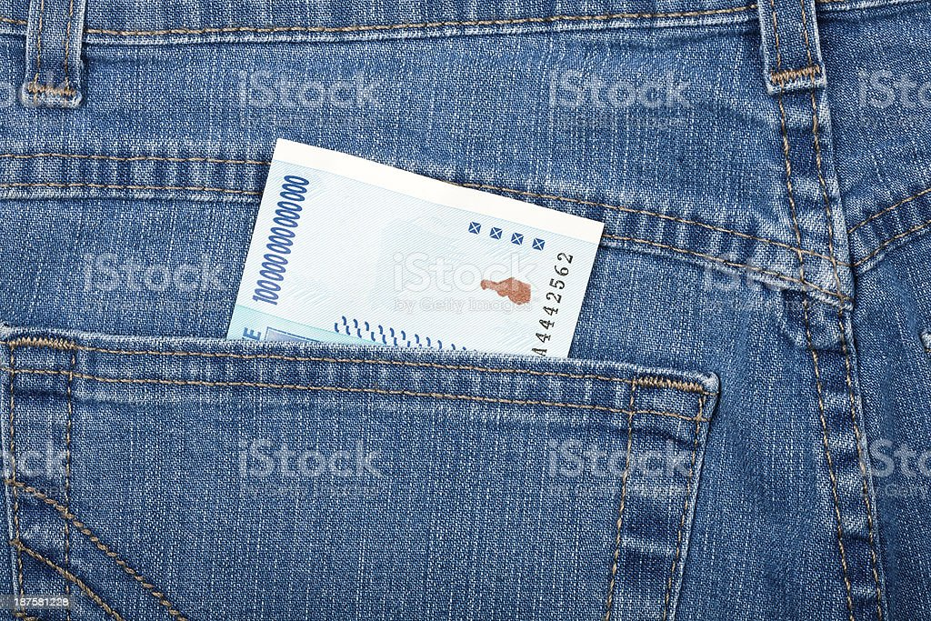 Money in pocket, blue jeans royalty-free stock photo