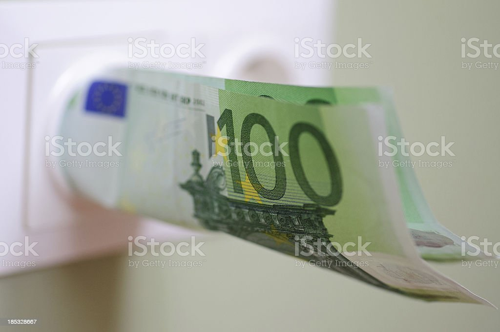 Money in power outlet - selective focus stock photo