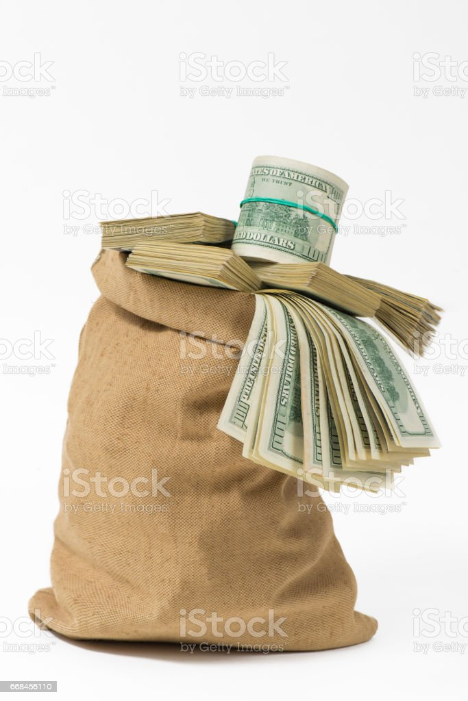 Money in the bag isolated on a white background стоковое фото