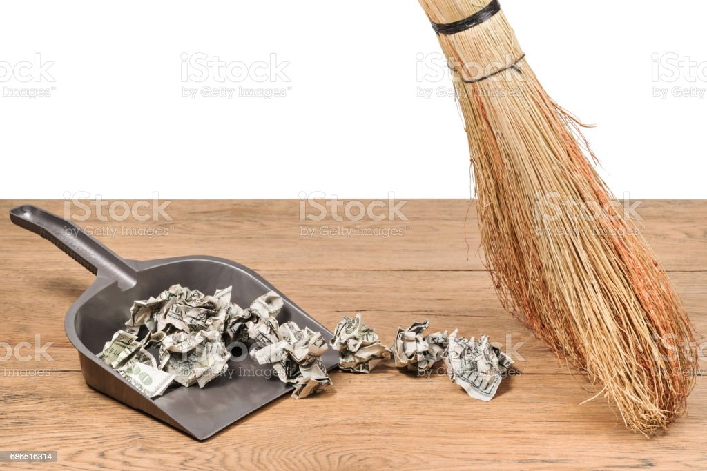 Money in the garbage scoop royaltyfri bildbanksbilder