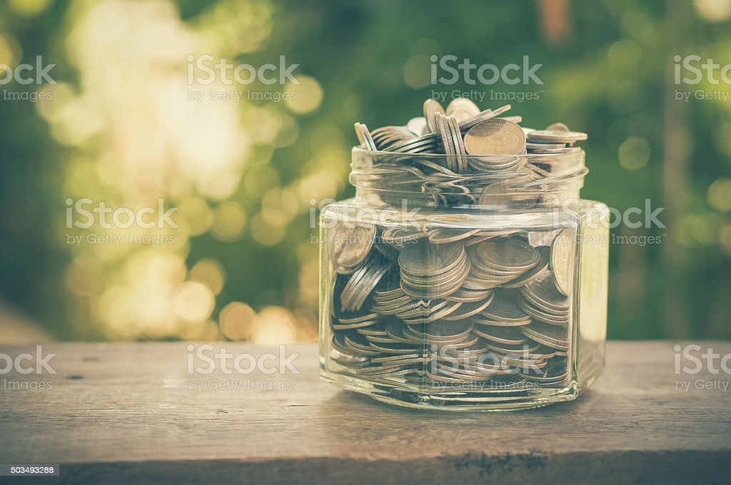 money in the glass with filter effect retro vintage style stock photo