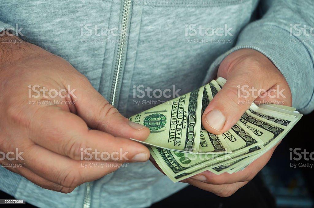 money in the hands stock photo