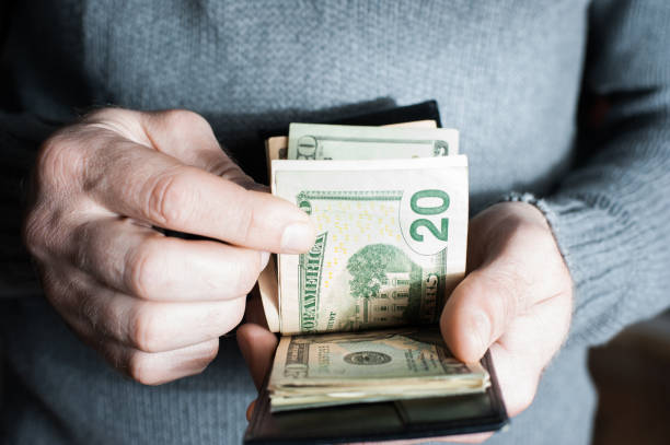 Money in the wallet. A man counting cash Money in the wallet. A man counting cash closeup wallet money stock pictures, royalty-free photos & images