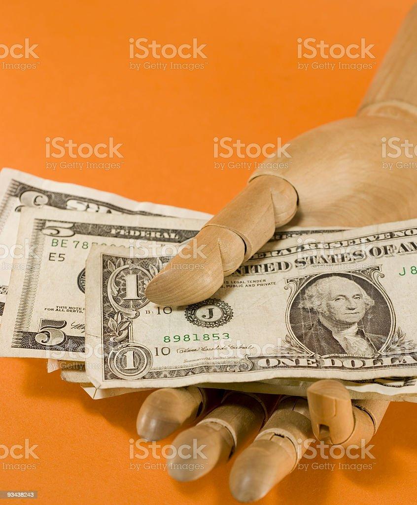Geld in der hand aus Holz Lizenzfreies stock-foto