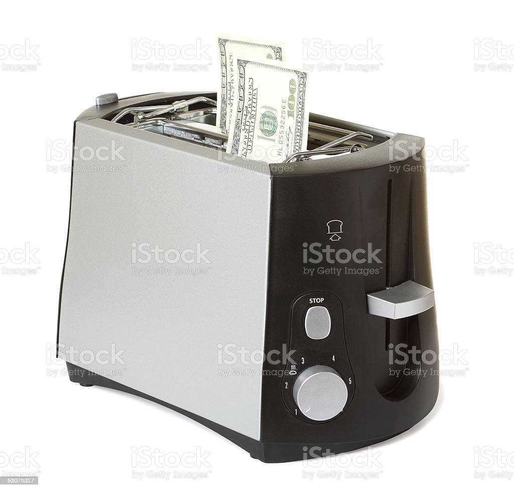 Money in toaster royalty-free stock photo