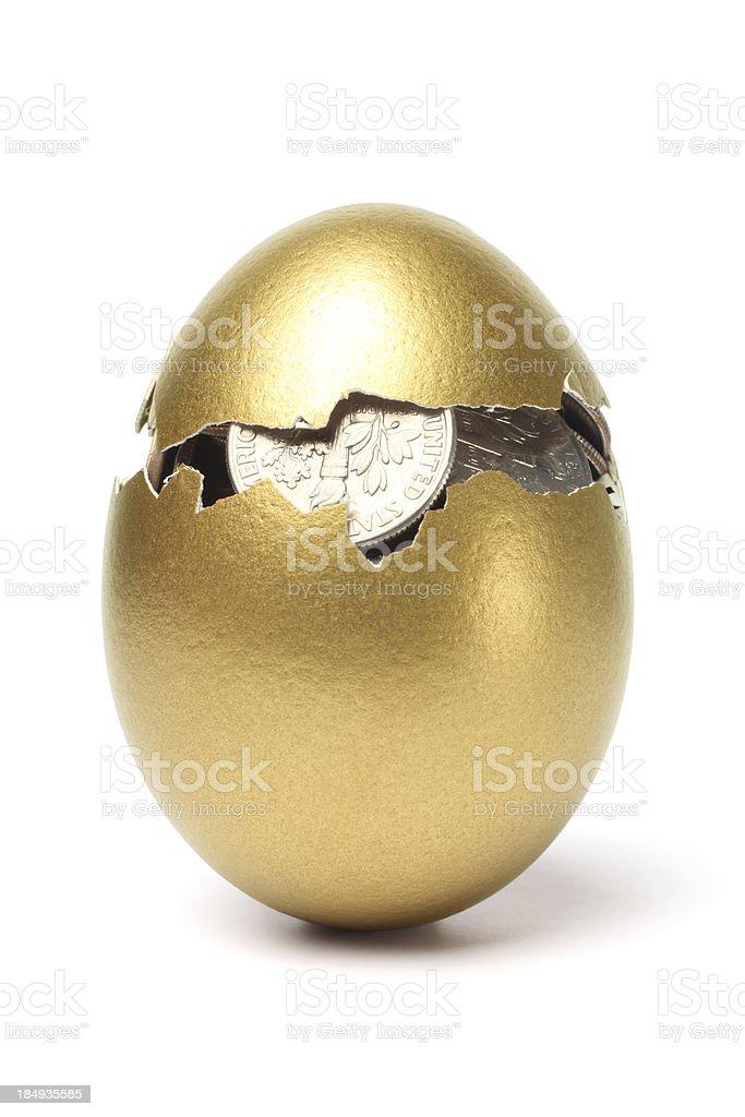 Money inside of Cracked Gold Egg on White Background stock photo