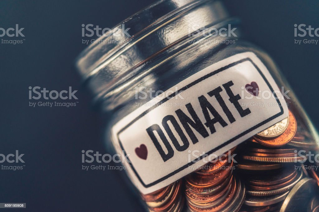 Money jar filled with cash for charitable cause – zdjęcie