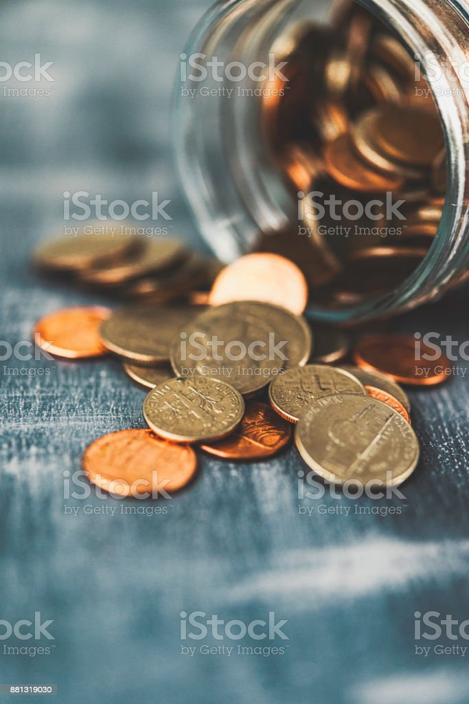 Money jar filled with cash for charitable cause stock photo