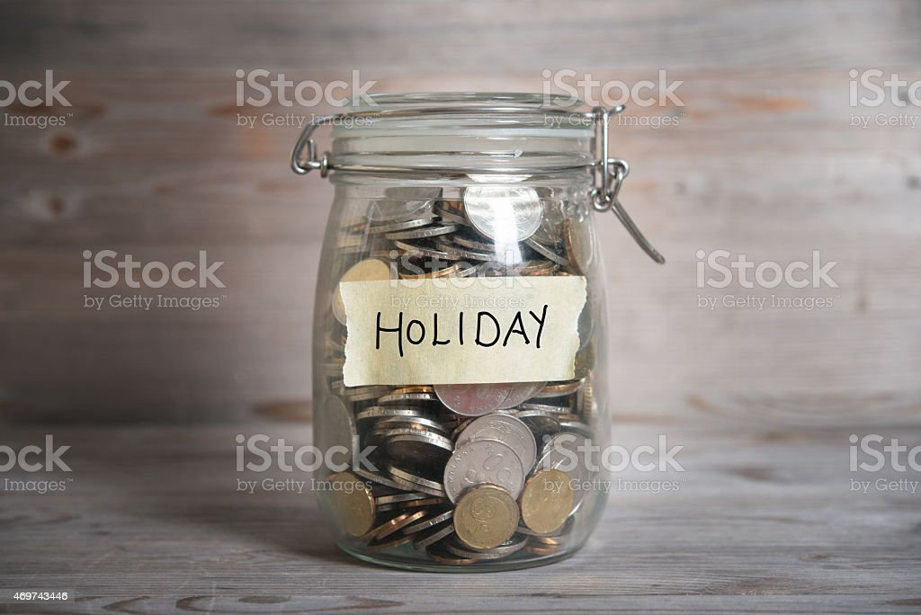 Money jar with holiday label. stock photo