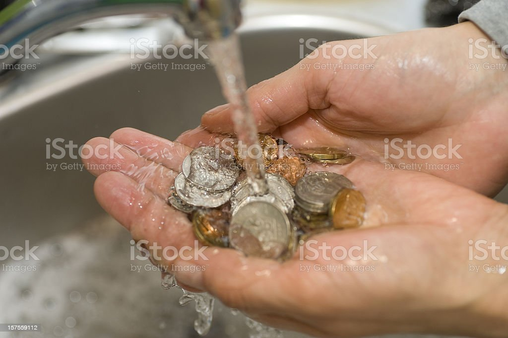 money laundering coins in sink with water royalty-free stock photo