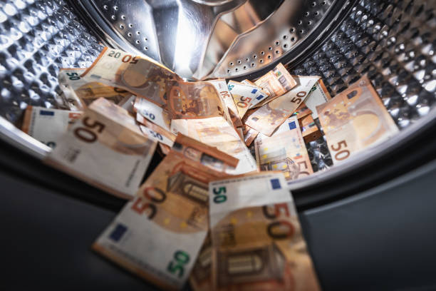 money laundering concept - euro banknotes in washing machine stock photo