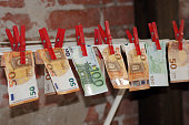 istock Money laundering euro notes on the clothesline 1021017738