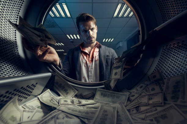 Money laundering Portrait of gangster with US dollars. Money laundering concept. drug dealer stock pictures, royalty-free photos & images
