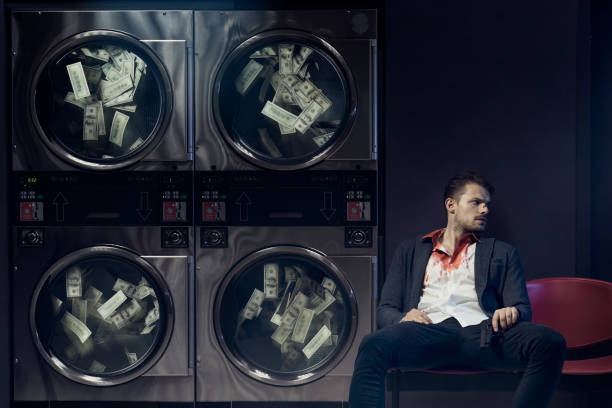 Money laundering Portrait of gangster washing US dollars. Money laundering concept. drug cartel stock pictures, royalty-free photos & images