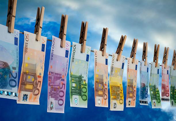 Blanqueo de dinero - foto de stock