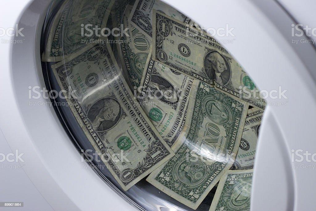 Dinero de lavandería y planchado foto de stock libre de derechos