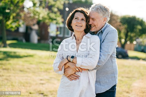 Senior women and senior men walking together
