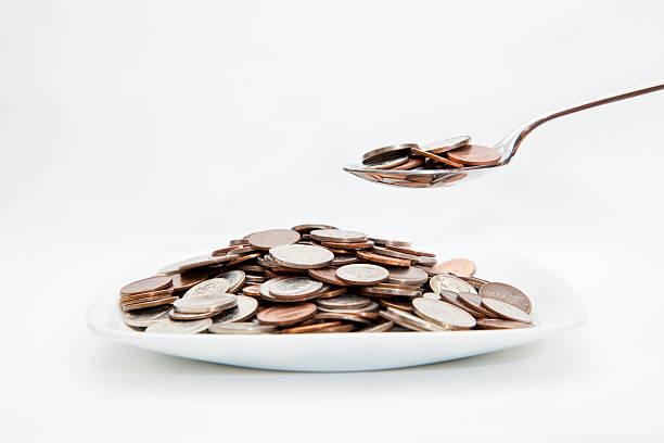 geld essen - besteck günstig stock-fotos und bilder