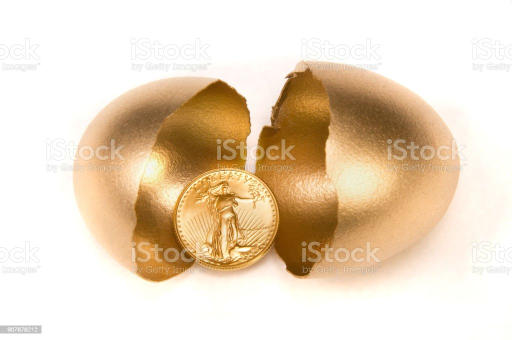 Money Nest Egg Golden Eggshell With America Double Eagle Gold Coin stock photo